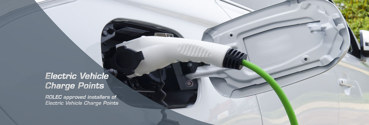 Image of car plugged into an electric vehicle charge point